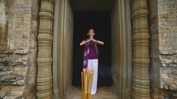 Thumbnail for Female Posing Like Buddhist Statue In Temple Doorway With Incense-  Angkor Wat Temple Cambodia 1