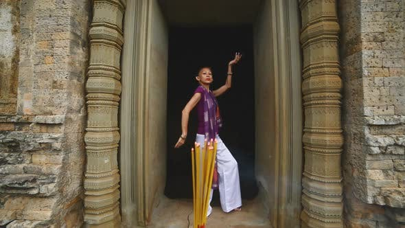 Thumbnail for Female Posing Like Buddhist Statue In Temple Doorway With Incense-  Angkor Wat Temple Cambodia 2