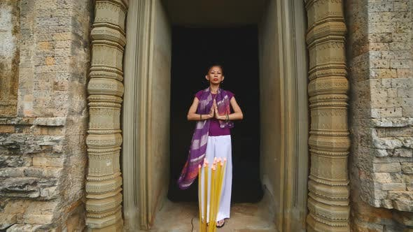 Thumbnail for Female Posing Like Buddhist Statue In Temple Doorway With Incense-  Angkor Wat Temple Cambodia 3