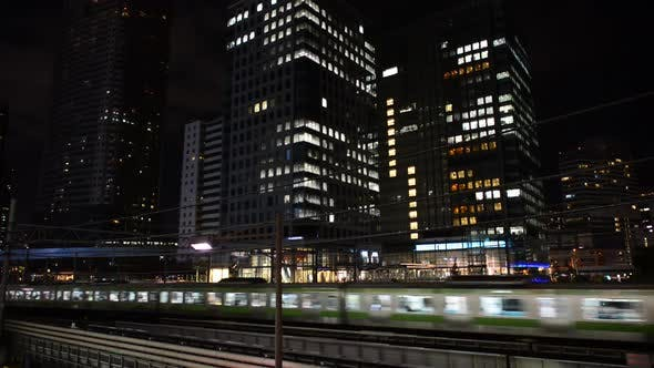 Train Passes Over Bridge In Central Tokyo Japan At Night 1