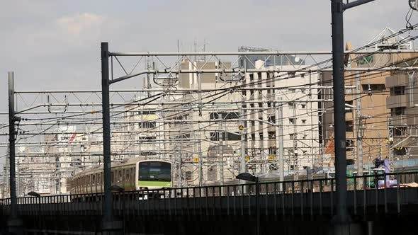 Thumbnail for Train Passes Over Bridge In Central Tokyo Japan Daytime