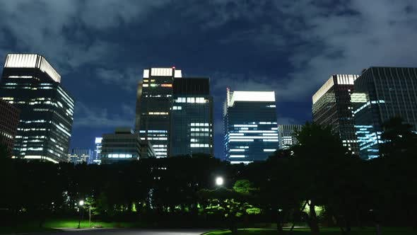 Downtown Tokyo Business District At Night With Clouds 2