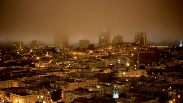Cover Image for Fog Passing Over San Francisco Skyline At Night 4