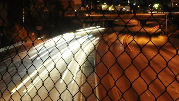 Thumbnail for Traffic Through Chain Link Fence 1