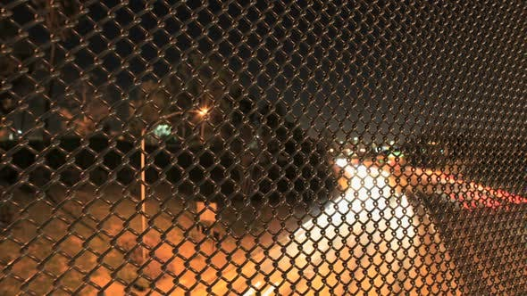 Cover Image for Traffic Through Wire Fence