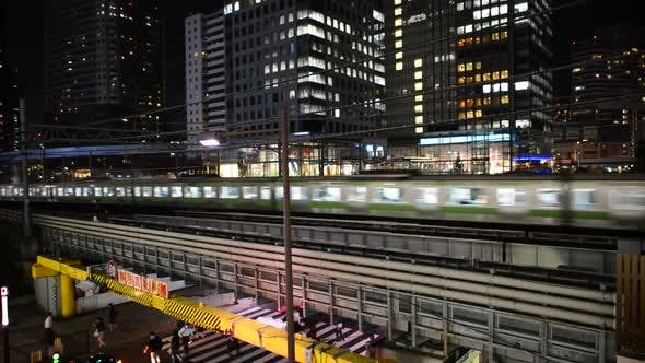 Thumbnail for Train Passing Over Bridge In Central Tokyo Japan At Night 1