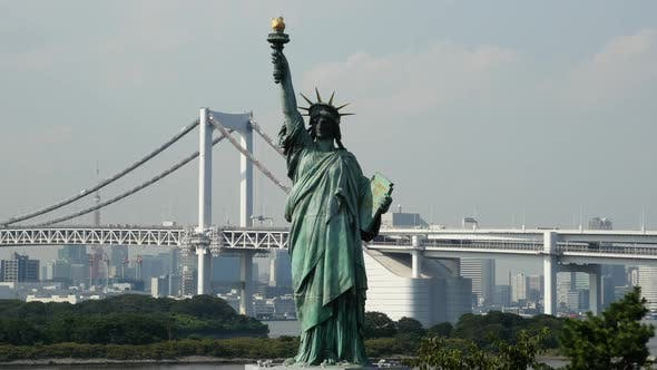 Replica Statue Of Liberty With Peace Bridge In The Background  -  Tokyo Japan 1