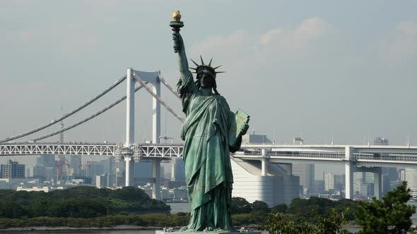 Thumbnail for Replica Statue Of Liberty With Peace Bridge In The Background  -  Tokyo Japan 4