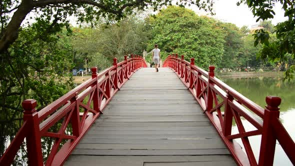 Thumbnail for Vietnamese Woman Walking Over The Huc Bridge On Hoan Kiem Lake In Hanoi Vietnam