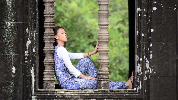 Cover Image for Female Buddhist Meditating In Temple Window - Angkor Wat, Cambodia
