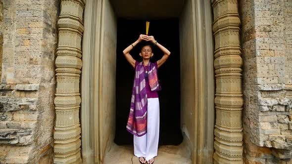 Thumbnail for Female Buddhist Praying With Incense In Temple Doorway -   Angkor Wat Temple Cambodia 1