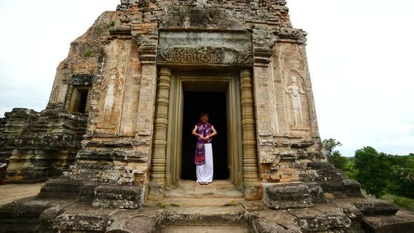 Thumbnail for Female Buddhist Praying With Incense In Temple Doorway -   Angkor Wat Temple Cambodia 3