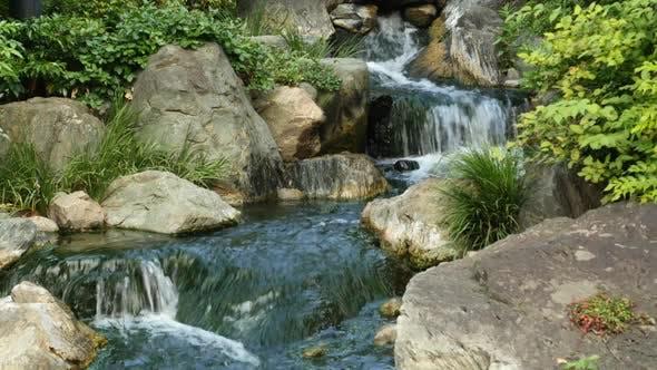 Thumbnail for Waterfall Runs Into A Koi Pond At Sensoji Temple Tokyo Japan 1