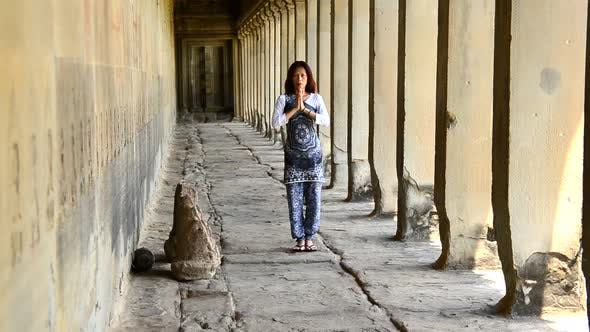 Thumbnail for Female Buddhist With Hands In Prayer In Temple Hallway  - Angkor Wat Temple Cambodia