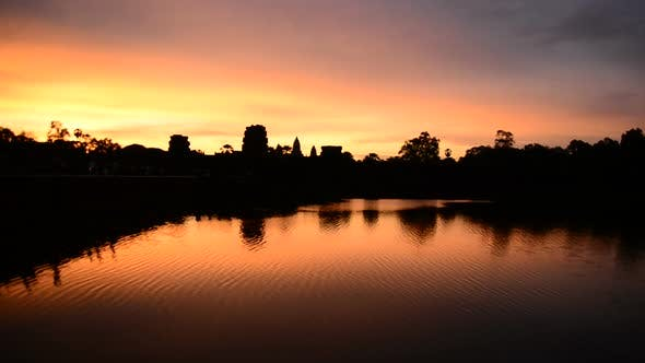 Silhouette Of The Main Temple Buildings With Lake Reflection At Sunrise - Angkor Wat, Cambodia 1
