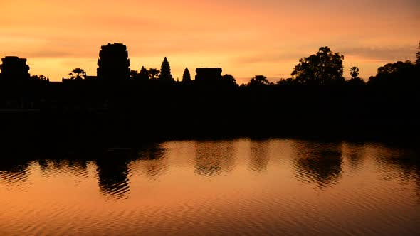 Silhouette Of The Main Temple Buildings With Lake Reflection At Sunrise - Angkor Wat, Cambodia 2
