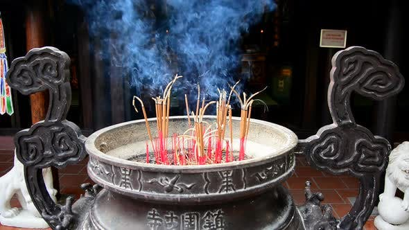 Thumbnail for Incense Sticks Burning In Giant Pot In Front Of Buddhist Temple 1
