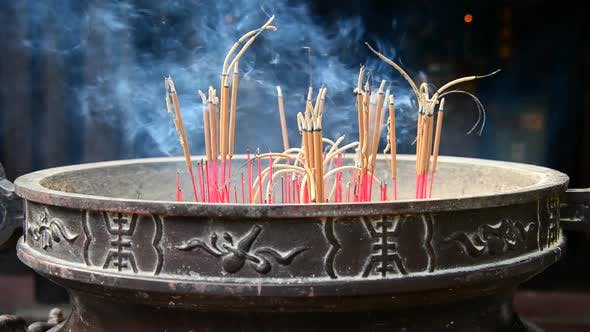 Thumbnail for Incense Sticks Burning In Giant Pot In Front Of Buddhist Temple 5