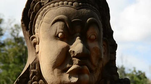 Zoom Out Of Stone Statue Of Buddha  - Angkor Wat, Cambodia 1
