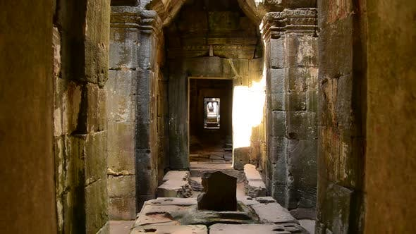 Thumbnail for Zoom Out Of Temple Hallway With Sunlight Shining In  - Angkor Wat Temple Cambodia