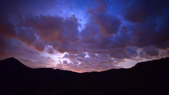 Cover Image for Time Lapse Pan Of Mountain Range At Night 2