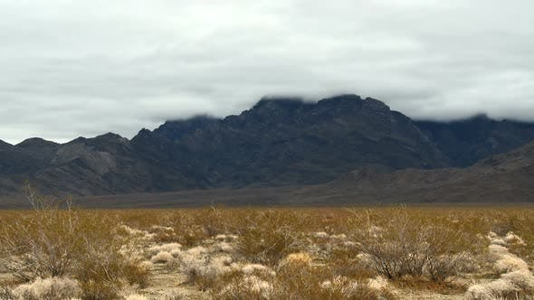 Cover Image for Time Lapse Of The Mojave Desert Storm Clouds - Clip 5