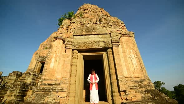 Cover Image for Female Buddhist Praying With Incense In Temple Doorway -   Angkor Wat Temple Cambodia 1