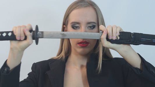 Thumbnail for Girl Pulls out a Samurai Sword From its Sheath