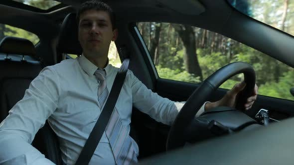 Thumbnail for Confident Businessman Driving Car in Countryside