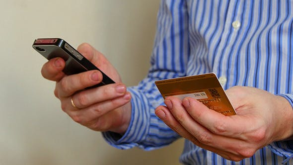 Thumbnail for Businessman Paying With Credit Card On Phone