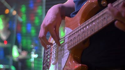Bass Guitar Player On A Stage
