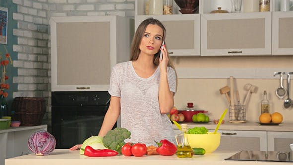 Cover Image for Woman Talking on the Phone in the Kitchen