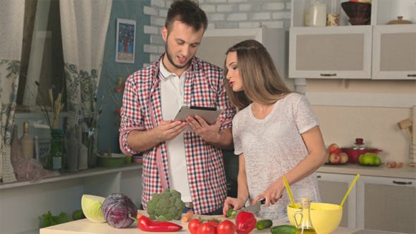 Thumbnail for Couple in Love are Cooking Using Tablet