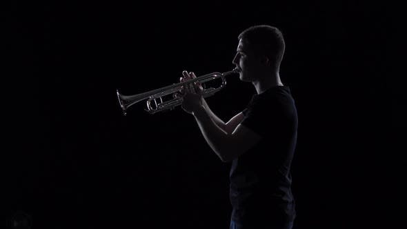 Thumbnail for Trumpeter Man Plays Melody in Slow Motion. Black Studio Background