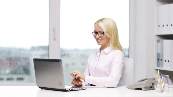 Thumbnail for Smiling Woman Secretary Or Student With Laptop