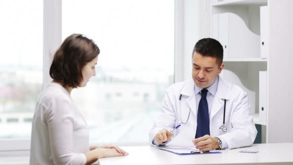 Thumbnail for Smiling Doctor And Young Woman Meeting At Hospital