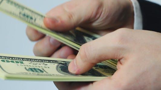 Thumbnail for Man Counts Dollars