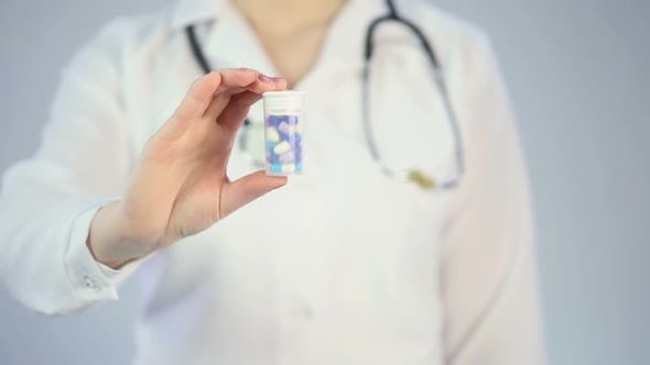 Thumbnail for Therapist giving patient pills to treat illness, medical drug promotion campaign