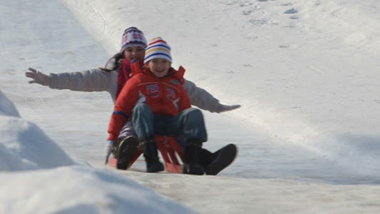 Thumbnail for Family Riding on Sledges