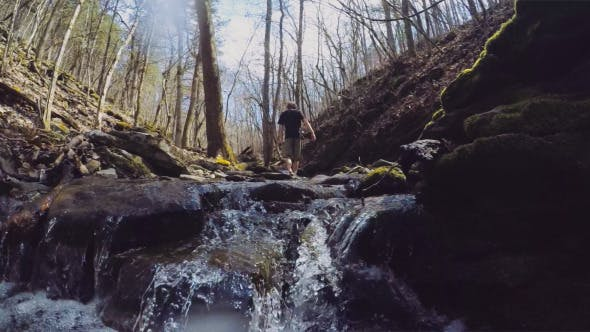 Thumbnail for Hiker Walking in Nature through Stream