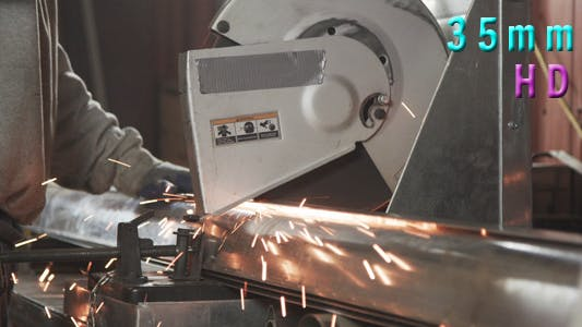 Thumbnail for Worker Cuts Metal With A Saw
