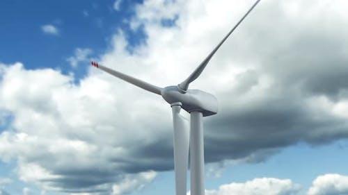 Wind Turbine Generator Produce Alternative Energy Against Skyline Timelapse