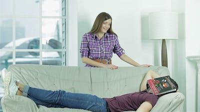 Boyfriend Resting On The Sofa