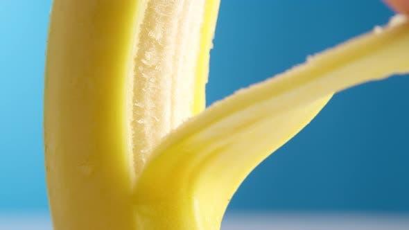 Macro Lens Shot Fresh Banana Gets Peeling on a Blue Background