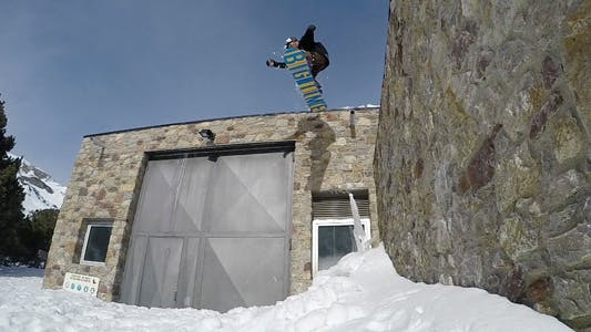 Thumbnail for Snowboard Jumping A Roof