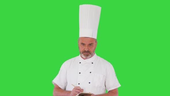Thumbnail for Senior Male Chef Takes Notes on a Green Screen Chroma Key
