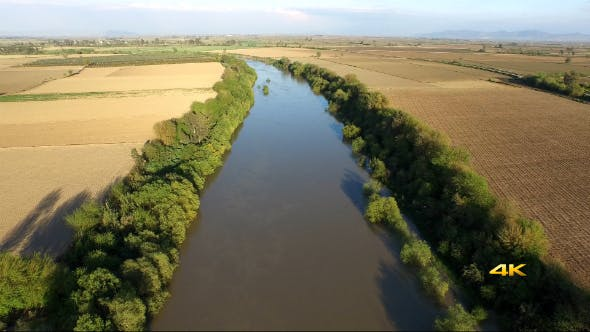 Thumbnail for Aerial View Flying Over River and Plain Fields 1