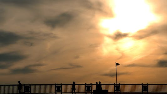 Thumbnail for People Silhouette on Bridge and Sunset