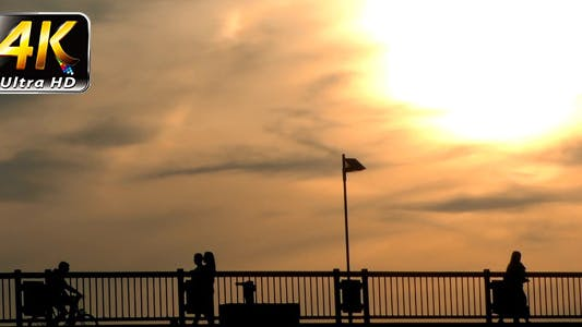 Thumbnail for People Silhouette on Bridge and Sunset 2