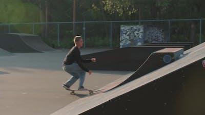 Guy Skating on Ramp in Skatepark